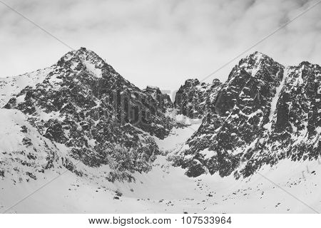 Vintage black and white photo os snow covered mountains