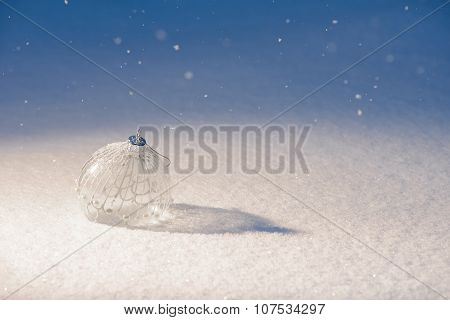 Christmas decoration ball on snow