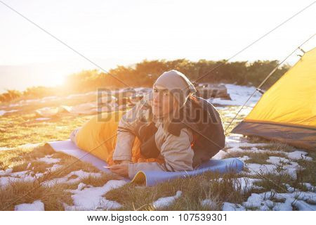 The Girl With The Phone Lying In A Sleeping Bag.