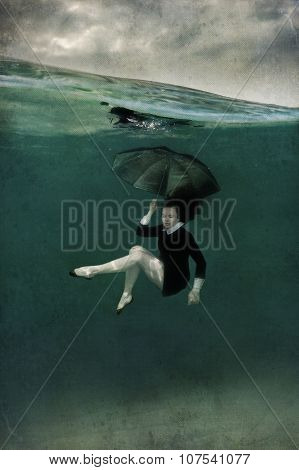Girl in black dress underwater