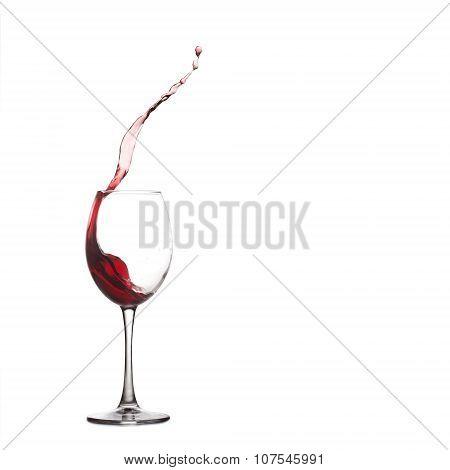 wine glass splash. Pouring natural red grape liquid into glass, close-up, white background. copy spa