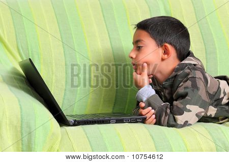 Curious Child With Laptop