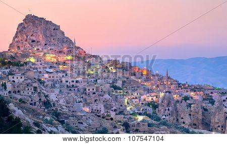 Uchisar Cave City In Cappadocia, Turkey On Sunset
