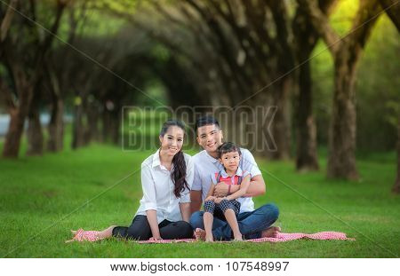 Happy Asian Mother, Father And Daughter
