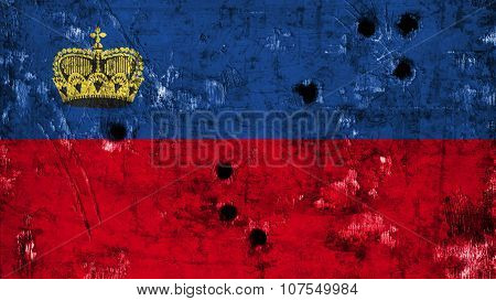 Flag of Liechtenstein painted on metal with bullet holes