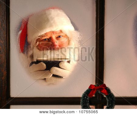 Santa Claus In Window With Mug