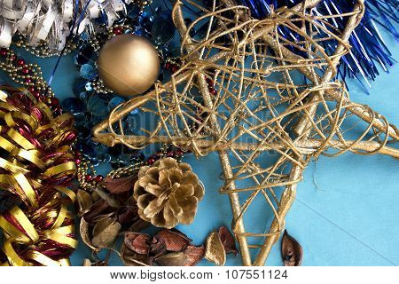Christmas composition with shiny decorations on a blue background