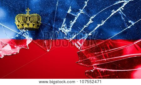 Flag of Liechtenstein painted on broken glass
