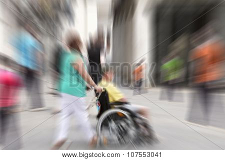 Abstract Background . A Disabled Person In A Wheelchair On A City Street. Radial Zoom Blur Effect De