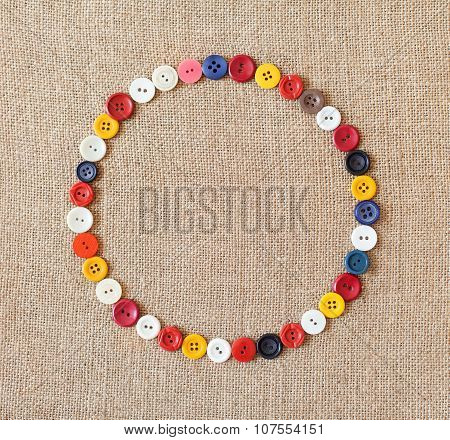 Circle From Buttons On Fabric Texture Background
