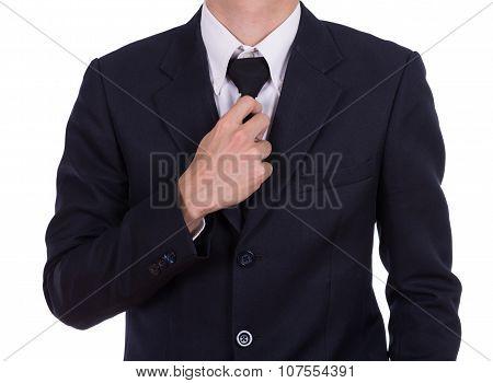 Businessman In Suit Tying The Necktie