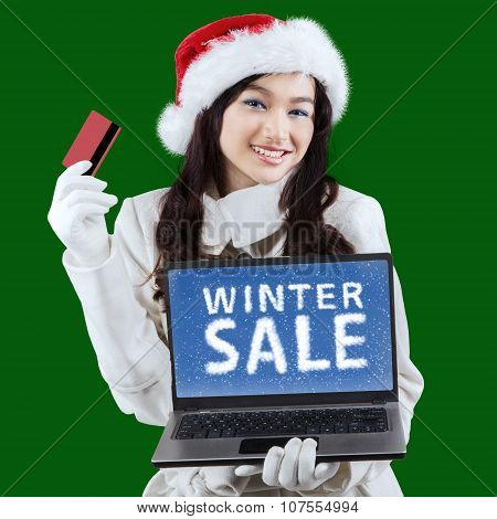 Young Lady With Laptop And Credit Card