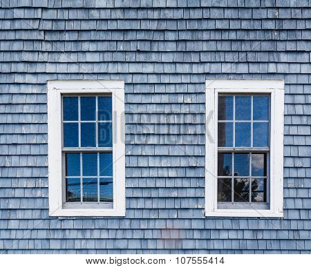 Two Windows In Blue Clapboard