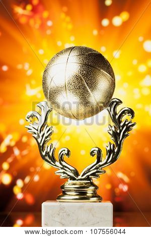 basketball trophy against shiny sparks background