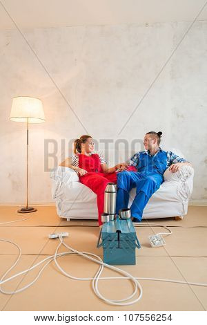 Young Couple In The Middle Of Renovation.