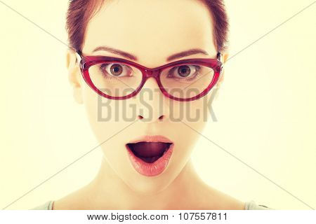 Young surprised woman in eyeglasses