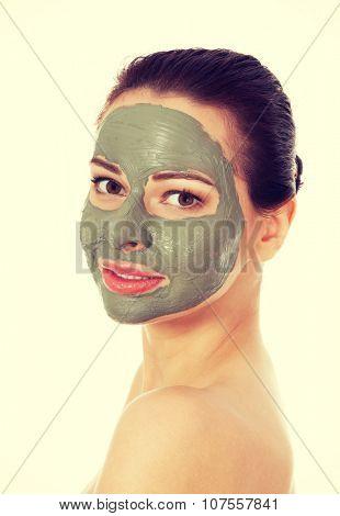 Beautifu toplessl woman with facial mask. Spa concept.