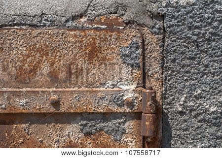 old rusty metal box on a concrete wall texture background