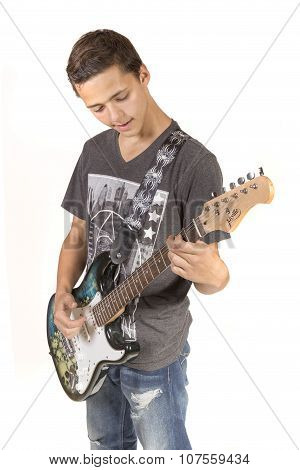 Teenage Boy Playing An Electric Guitar
