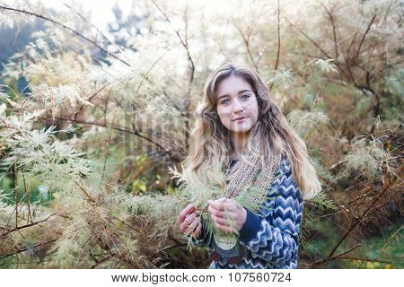 Young Girl Near A Conifer