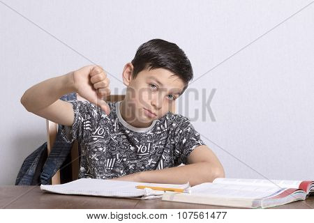 Young Boy Doing His Homework Giving Thumbs Down