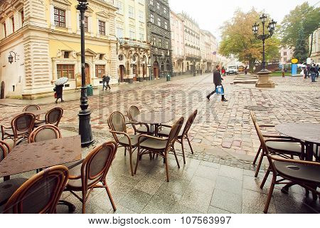 Cold Morning On Cobbled Streets With Empty Outdoor Restaurants Of The Old Town