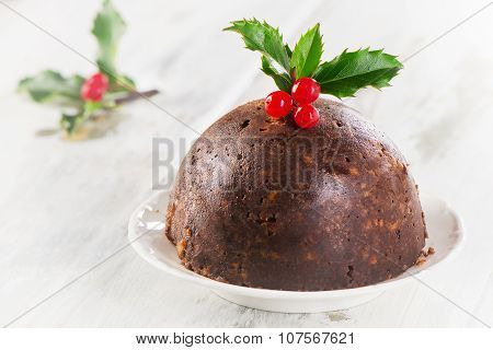 Christmas Pudding With Holly On A Plate.