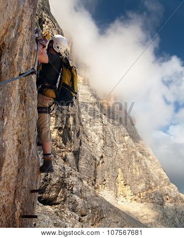 Climber On Via Ferrata Or Klettersteig - Dolomites