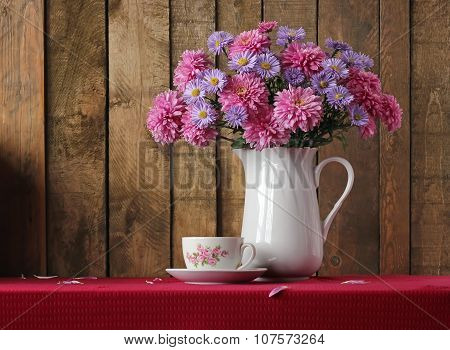Still Life With A Bouquet Of Autumn Flowers And A Retro A Cup.