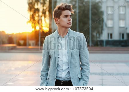 Portrait Of A Cheerful Young Businessman At Sunset.