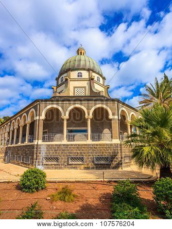 The lake Tiberias. Basilica of the monastery of Mount Beatitudes. The magnificent dome surrounded by a colonnade