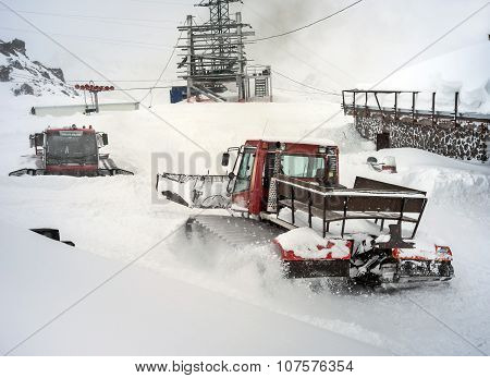 Snowcat In Motion In Mountains