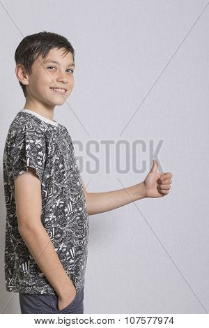 Portrait of Young Boy With Thumbs Up Gesture
