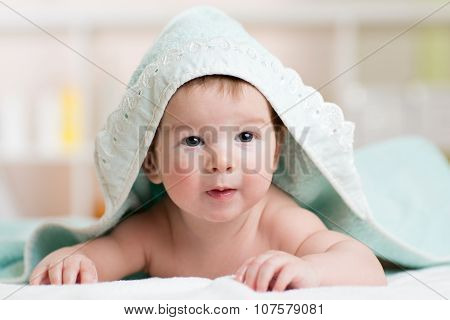 happy baby under towel indoor
