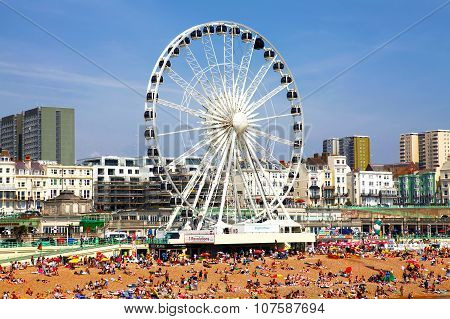 BRIGHTON -JULY 14 - View the golden sand of Brighton beachfront to the ferris wheel and amusement p