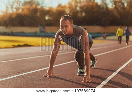 Athletic Man Standing In Posture Ready To Run On A Treadmill