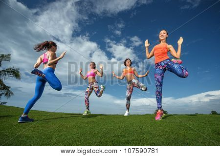 Bright beautiful young girl in sports dance