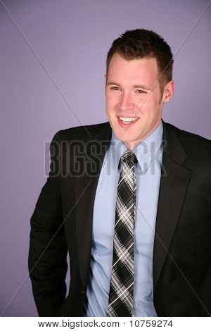 Happy Man In Business Suit Smiling