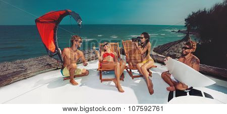 Surfer and kiter boys with beautiful girls group stay on beach