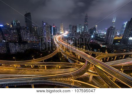 Modern city traffic road at night. Transport junction.
