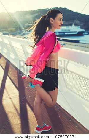 Beautiful fit woman engage physical activity outdoors in windy summer evening