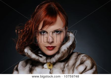 Redhead woman with fur coat