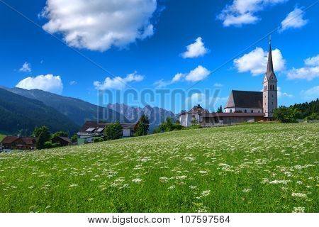 Christianity churh in Gosau village at sunny day. Alps, Austria, Europe.
