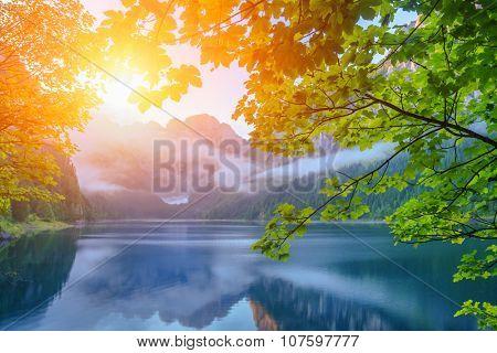 Fantastic morning on mountain lake Gosausee, located in the Austia. Dramatic unusual scene. Alps, Europe.