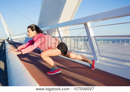 Fit woman with perfect body working outdoors during recreation time