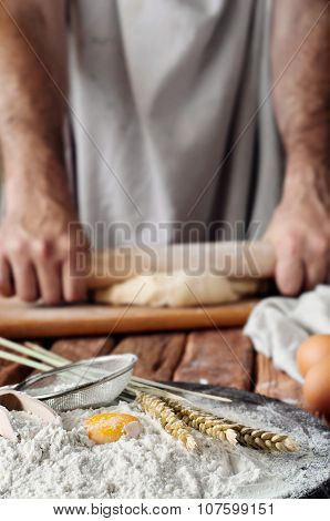 Handful Of Flour With Egg On A Rustic Kitchen