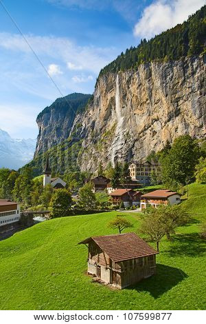 Famous village Lauterbrunnen in swiss alps - starting point for train tours in the Jungfrau region