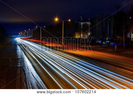 Highway at night with the lights from cars