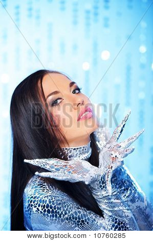 Beautiful brunette with long nail gloves