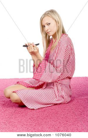 Young Woman Dressed Pink/White Bathrobe Filing Nails